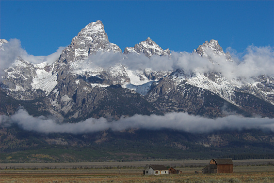 Peaks of the Teton Range from a location known as Mormon Row where old farmstead structures remain on the park site.