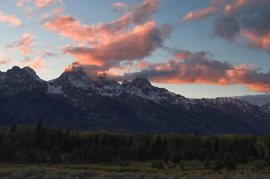 Grand Teton sunset with statocumulus clouds illuminated pink by the setting sun